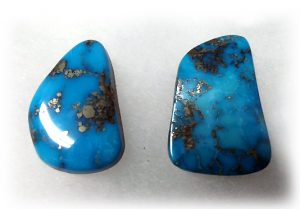 Image of two Morenci turquoise stones that are dark blue with fools gold webbing