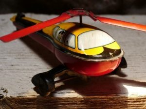 Image of the front view of the Wyandotte helicopter showing the yellow top, red bottom, and red propellers.