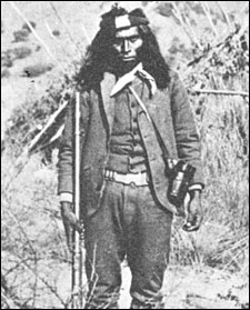 Apache Kid standing in Sergeant uniform