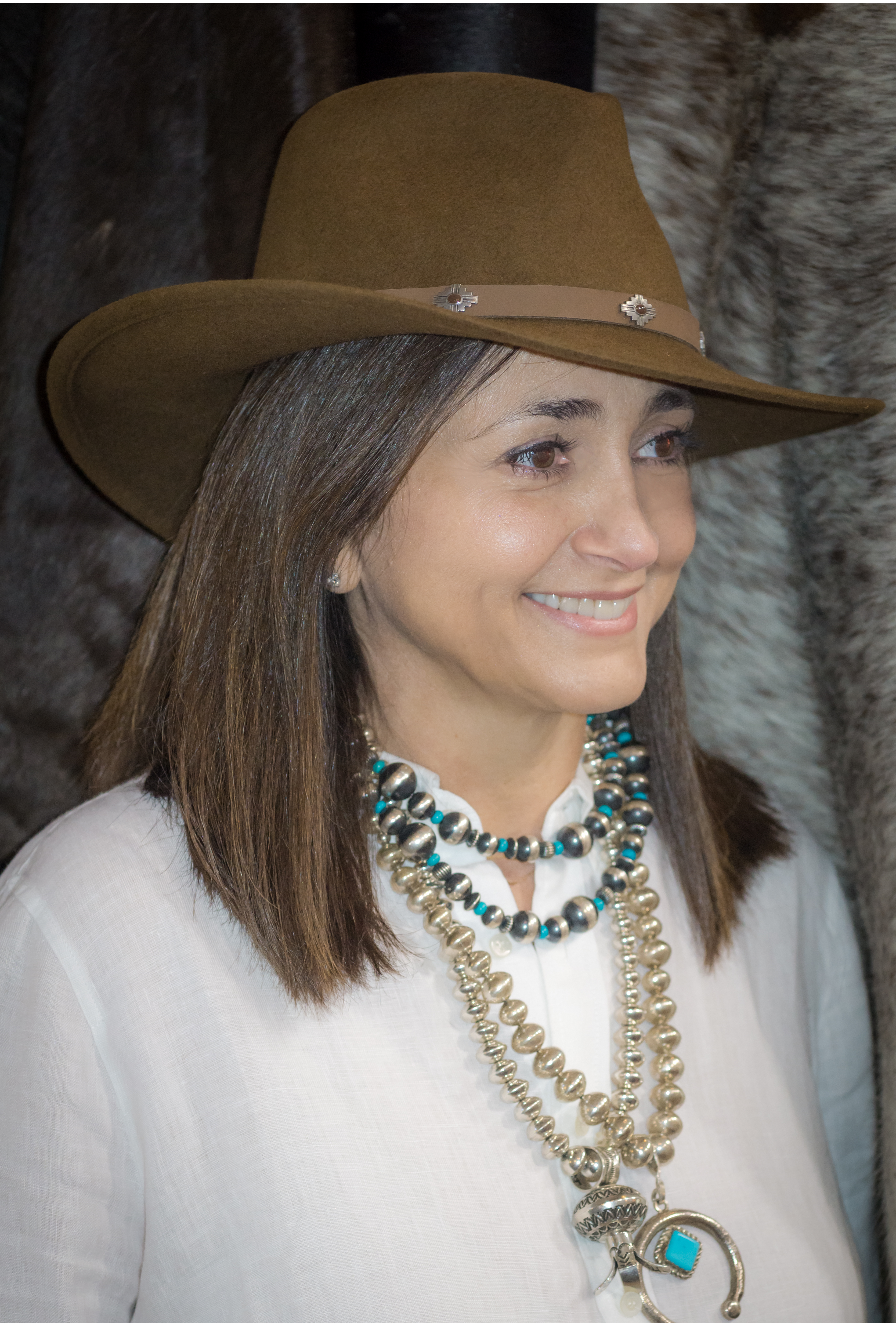 Wearing Naja pendant with turquoise and Navajo pearls