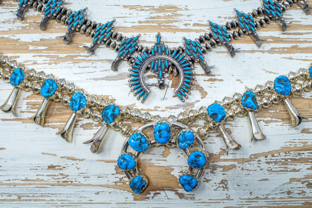 Turquoise Squash Blossom Naja Necklace on Table