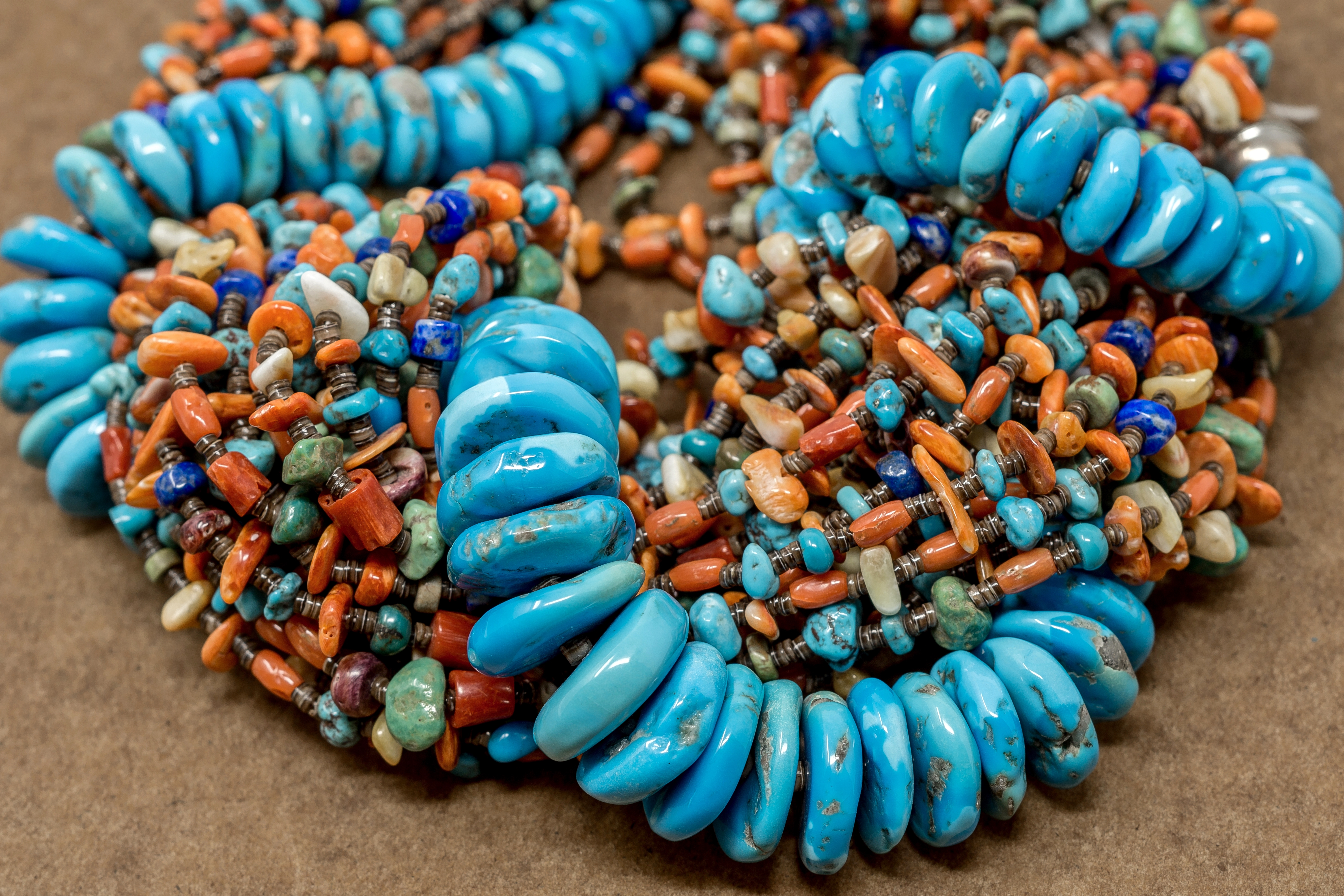 Multiple shells and stones, complimented by turquoise disc beads, make up this ravishing necklace.