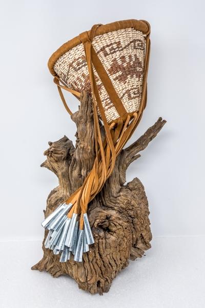 San Carlos Apache weaver Mary Jane Dudley's butterfly design burden basket.