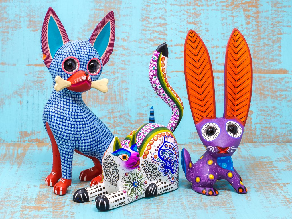 Brightly painted copal wood carvings (alebrijes) from Mexico.