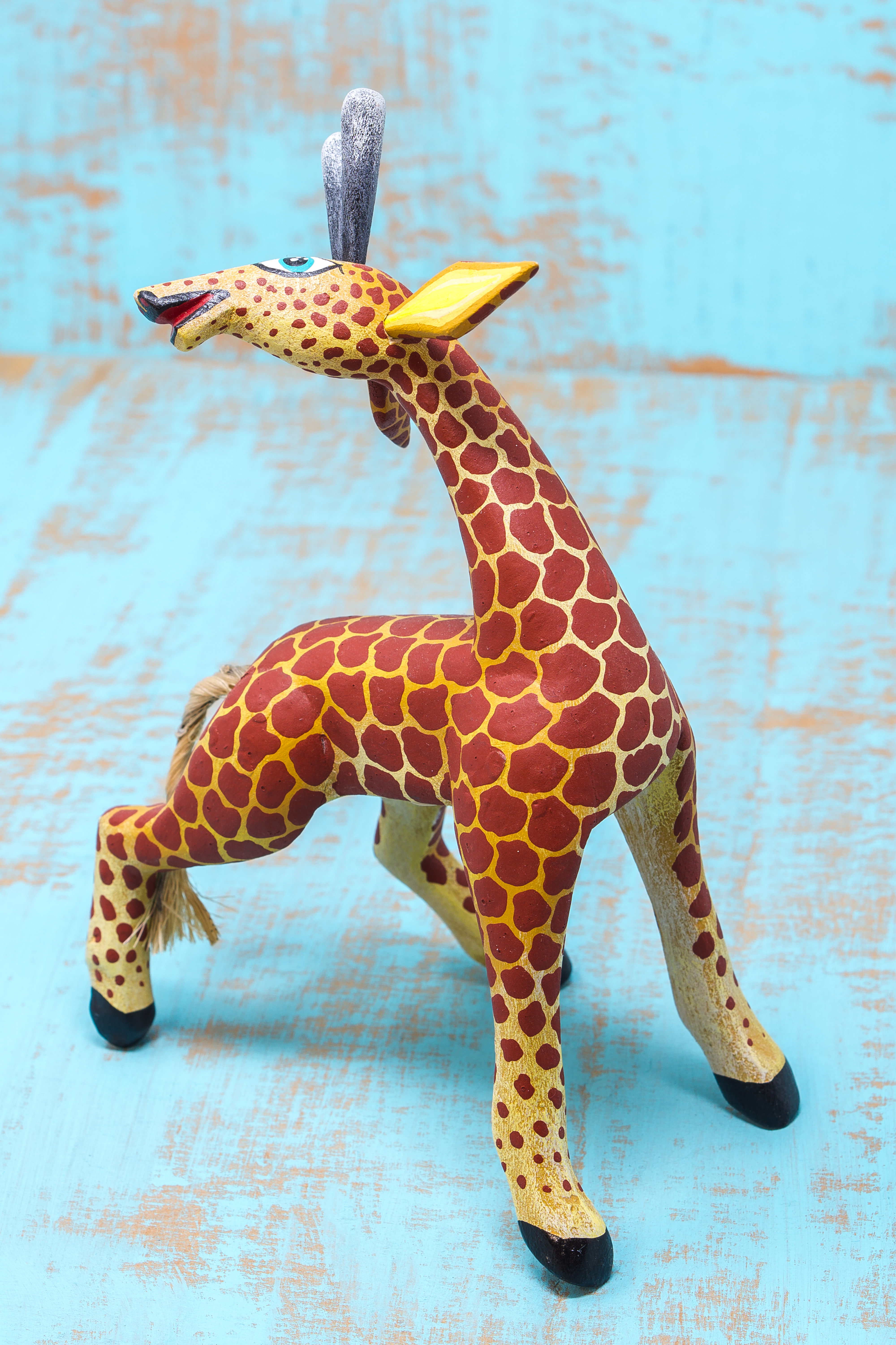 Oaxacan wood carving of a giraffe