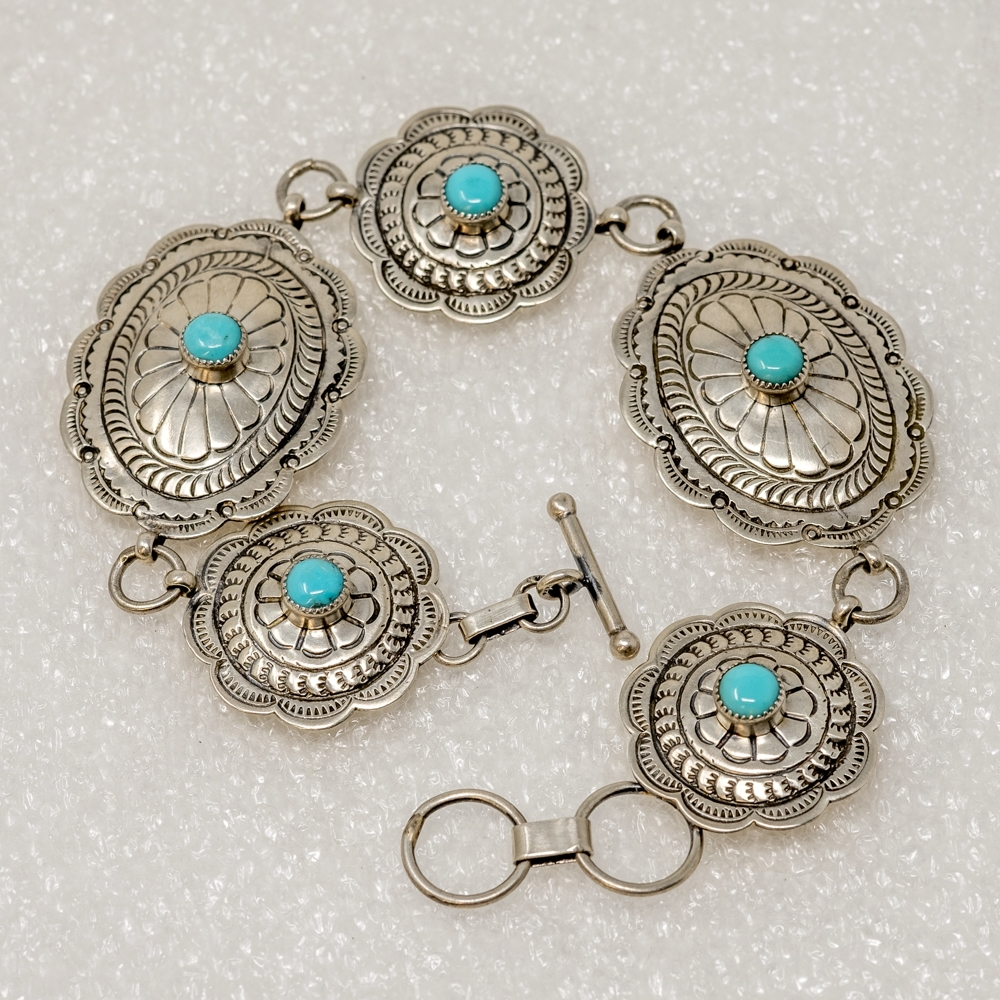The concho bracelet, an emblematic symbol of the great American Southwest, features cabochons of Kingman turquoise