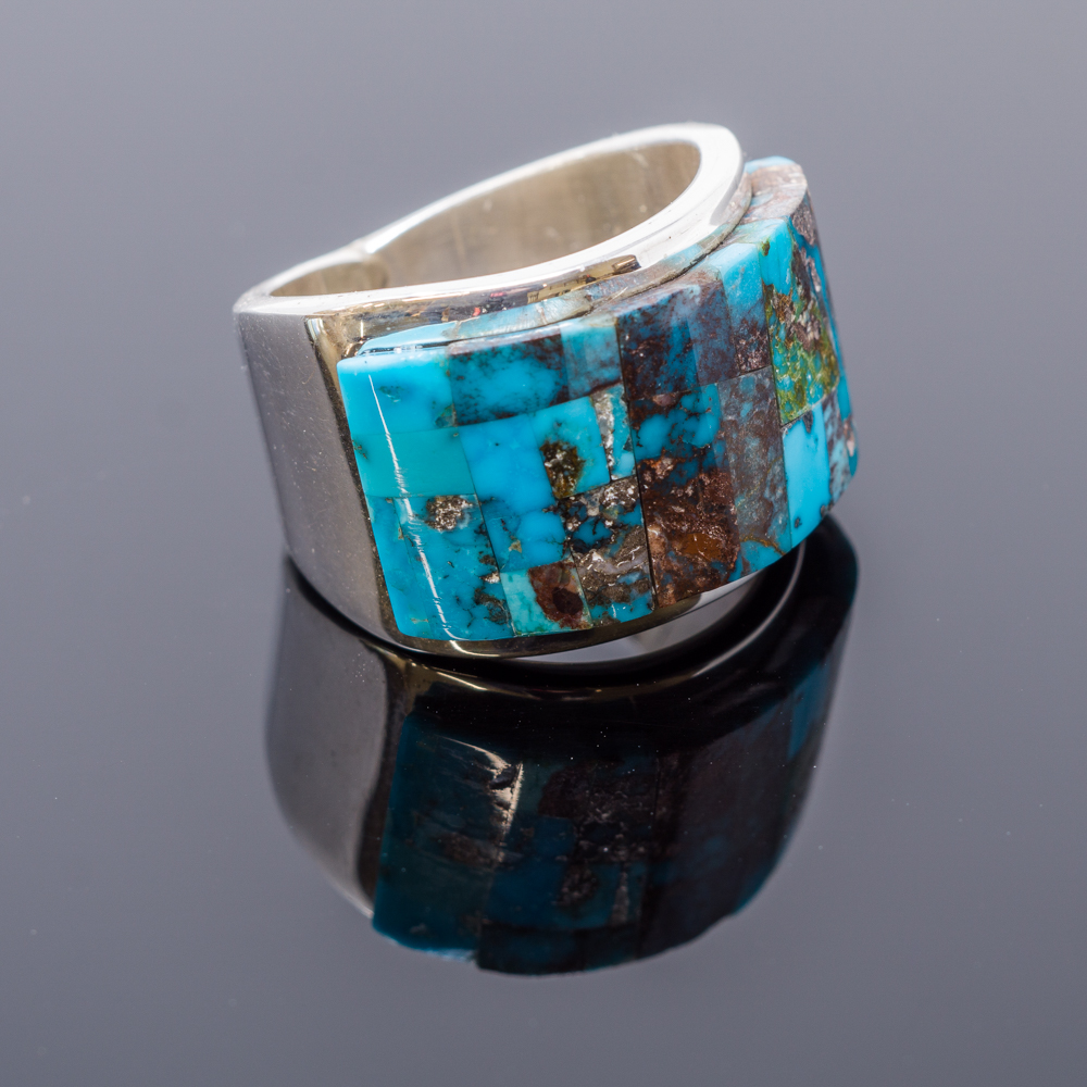 A mosaic of Bisbee turquoise with sterling silver defines a ring by noted internationally known Navajo designer and silversmith Tommy Jackson
