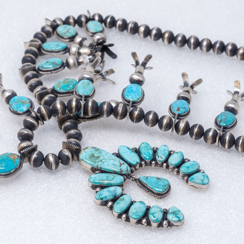 Noted Navajo designer and silversmith Andy Cadman's handcrafed Turquoise Mountain squash blossom necklace with sterling silver Navajo pearls