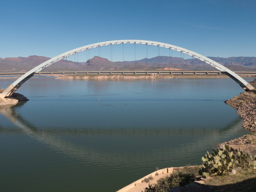 The majestic Lake Roosevelt Bridge spans Lake Roosevelt, a major attraction of the Tonto National Monument in Arizona