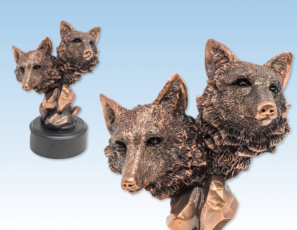 Copper plated bust of two wolves