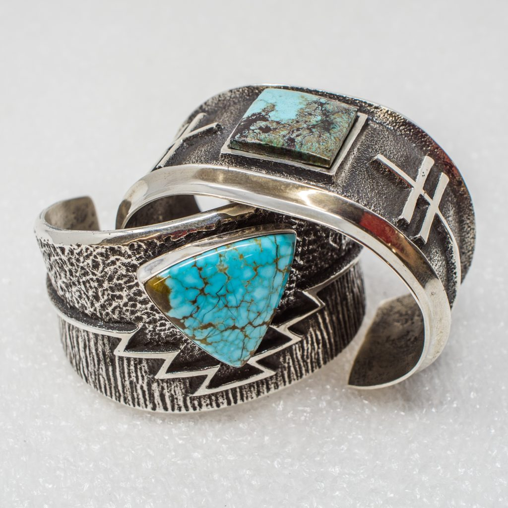 Turquoise cuff bracelets by Aaron Anderson utilizing the tufa stone-casting process