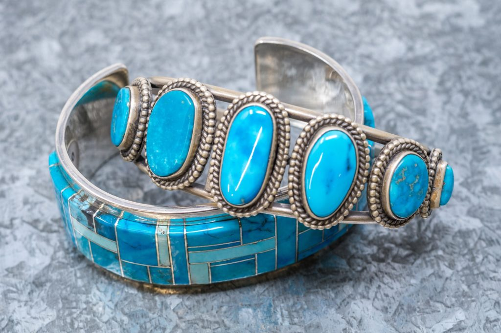 Sterling silver and turquoise cuff bracelets by Elgin Sam and Tommy Jackson