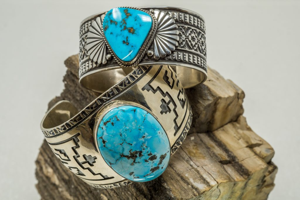Turquoise cabochons in hand stamped sterling silver cuff bracelets by Sunshine Reeves and E.M. Teller