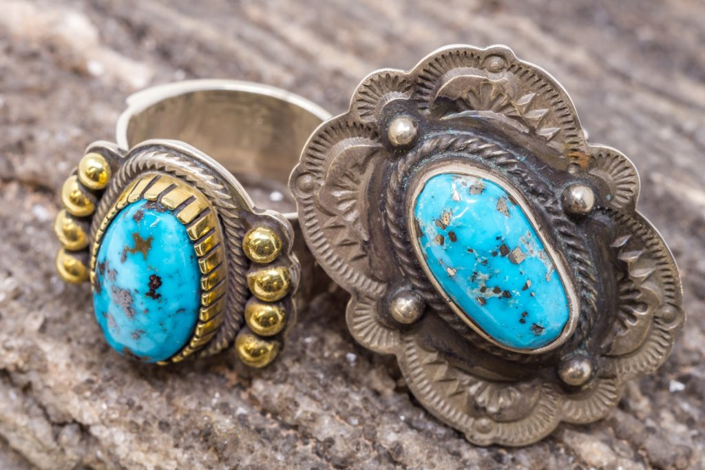Rings by Navajo silversmith Tommy Jackson, featuring turquoise in 18KT gold and in sterling silver