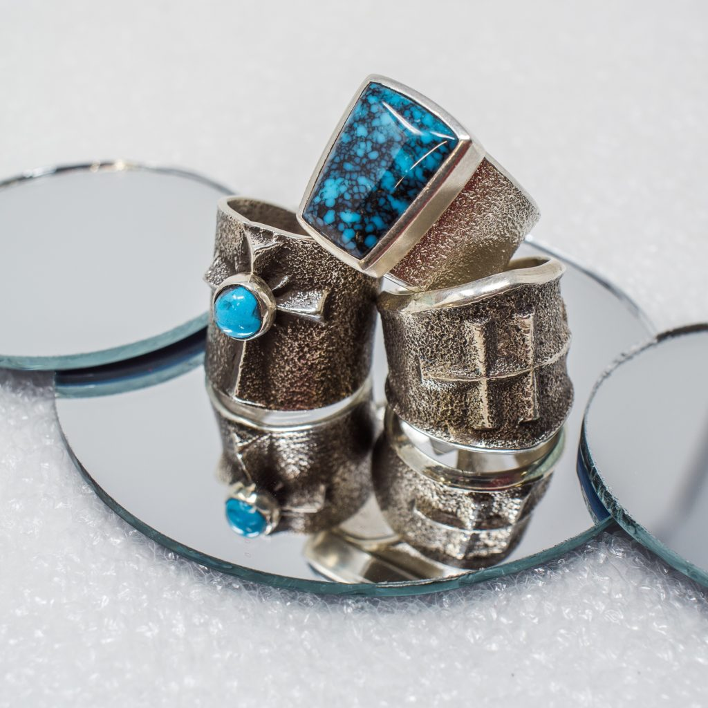 Turquoise rings by Aaron Anderson and Darryl Dean Begay utilizing the tufa stone-casting process