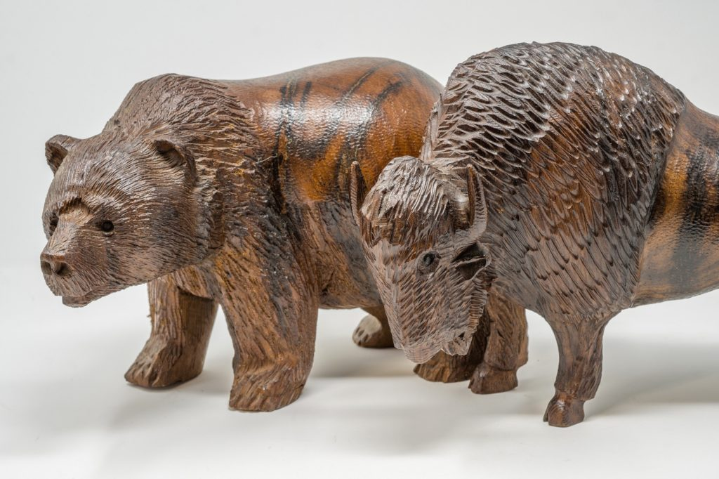 bear and buffalo carved out of ironwood