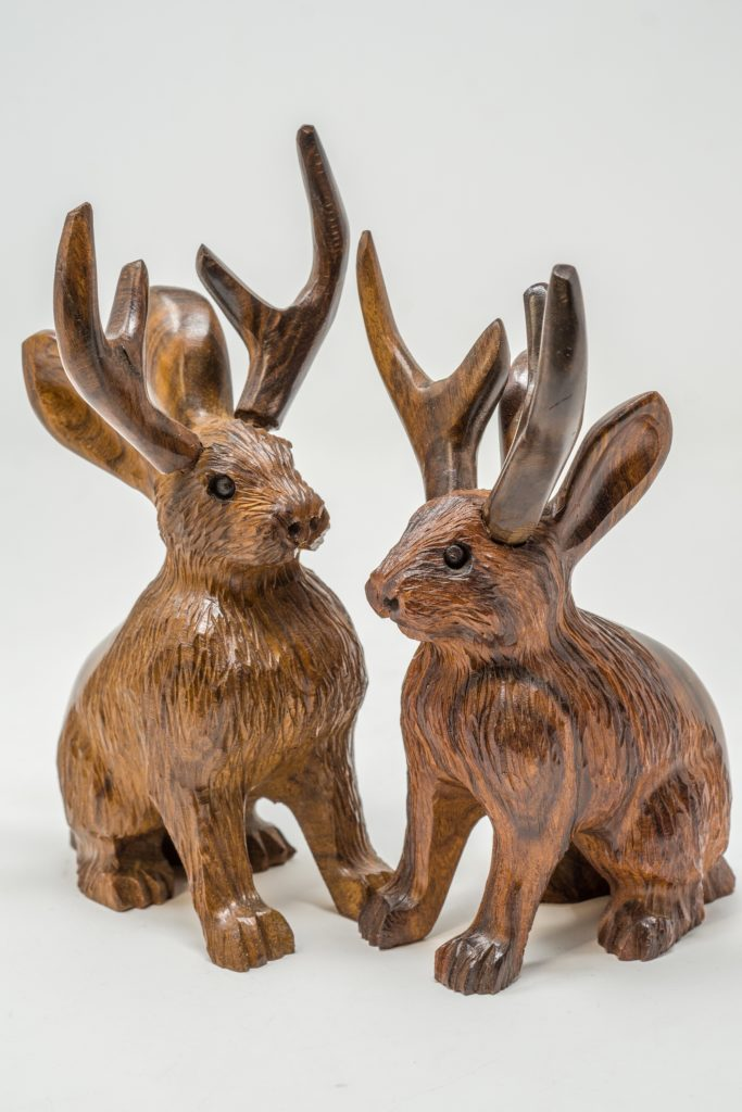 ironwood carving of the mythical animal jackalope