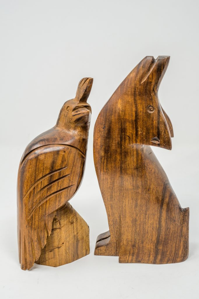 Carved ironwood quail and coyote
